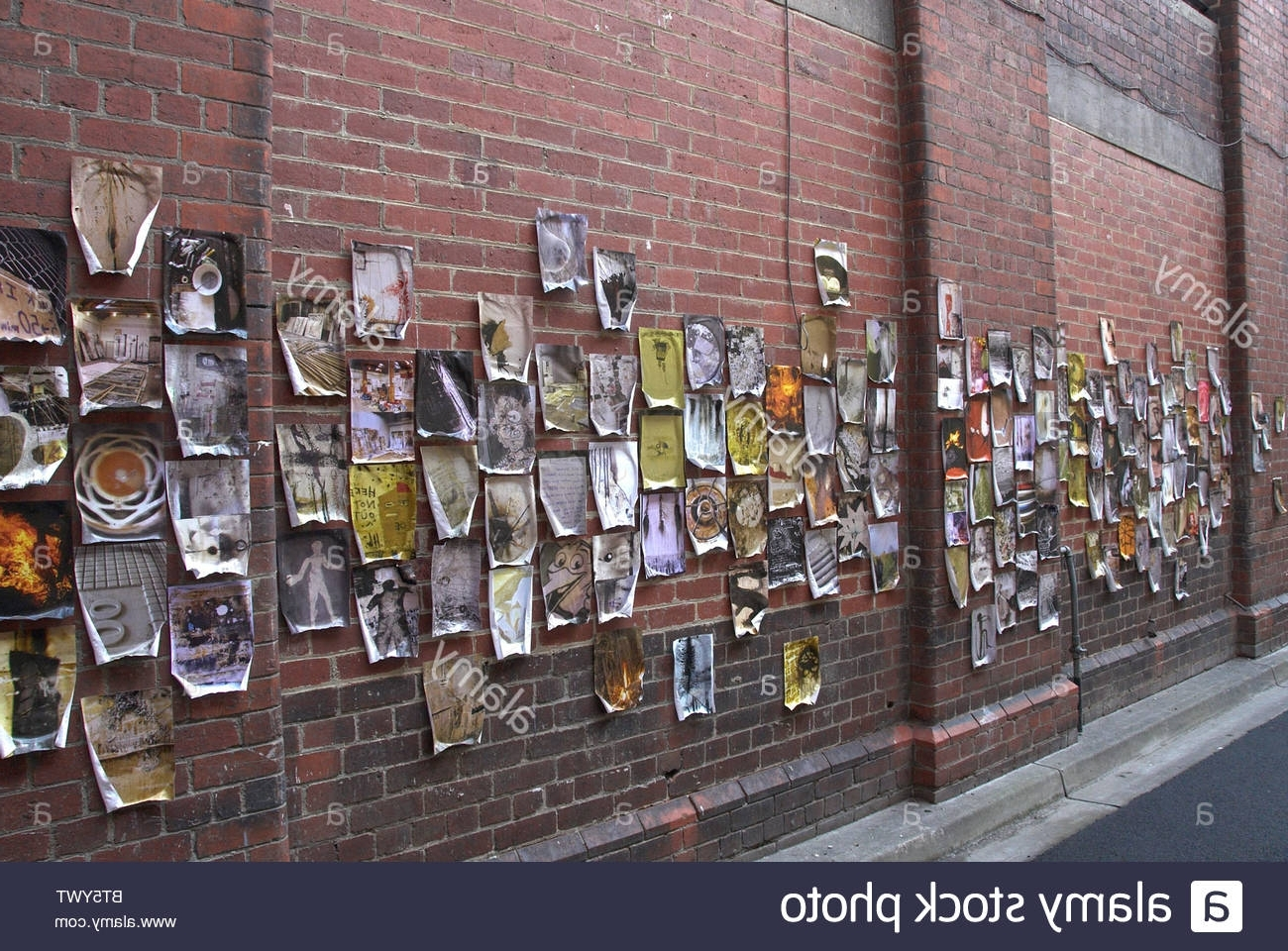 Famous Hanging Wall Art For Brick Wall Inside Artwork Hanging On Brick Wall In Melbourne, Australia Stock Photo (View 2 of 15)
