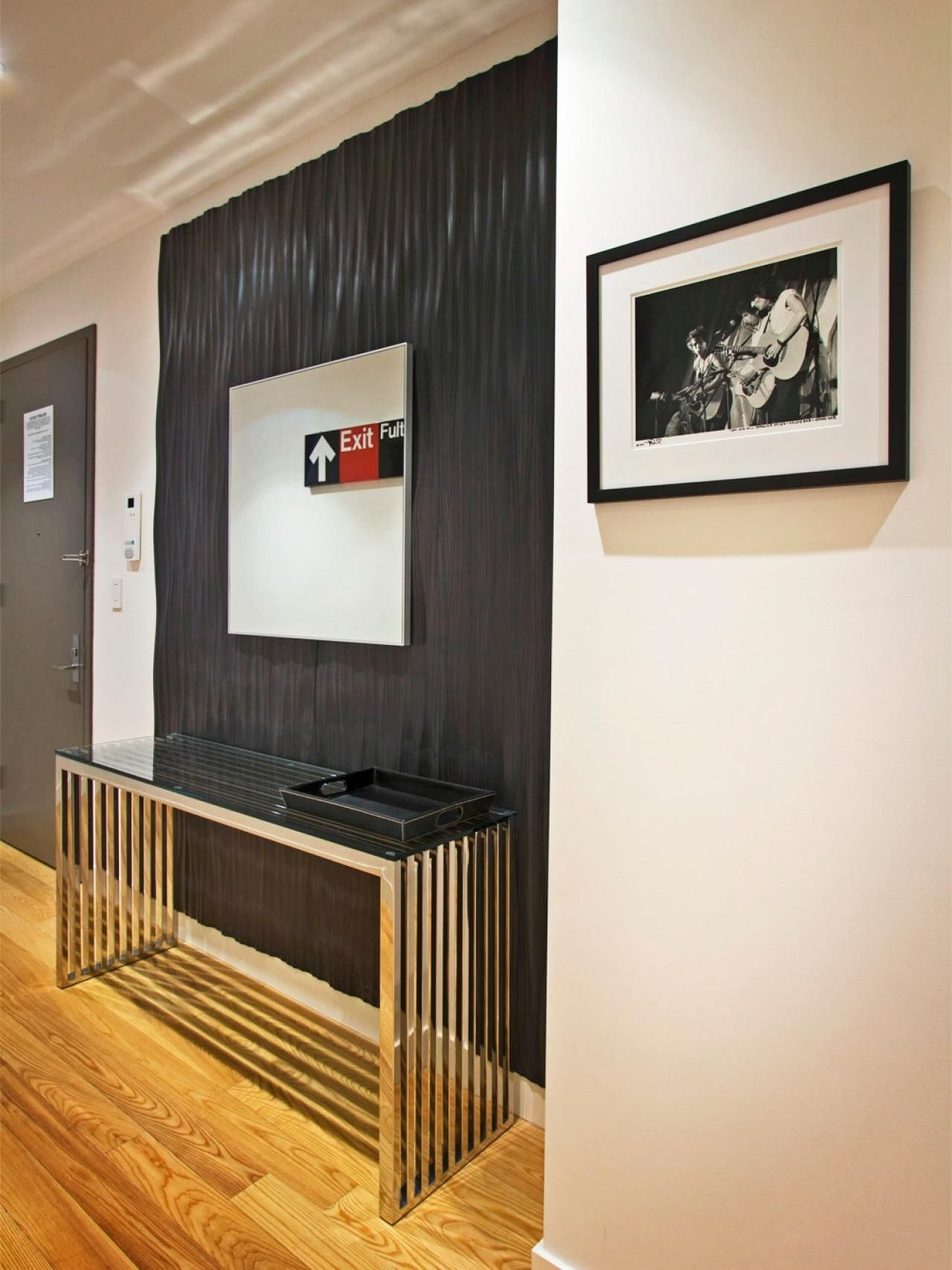 Best And Newest Entryway Wall Accents Pertaining To This Contemporary Entryway Features A Textured Ebony Accent Wall (Gallery 1 of 15)