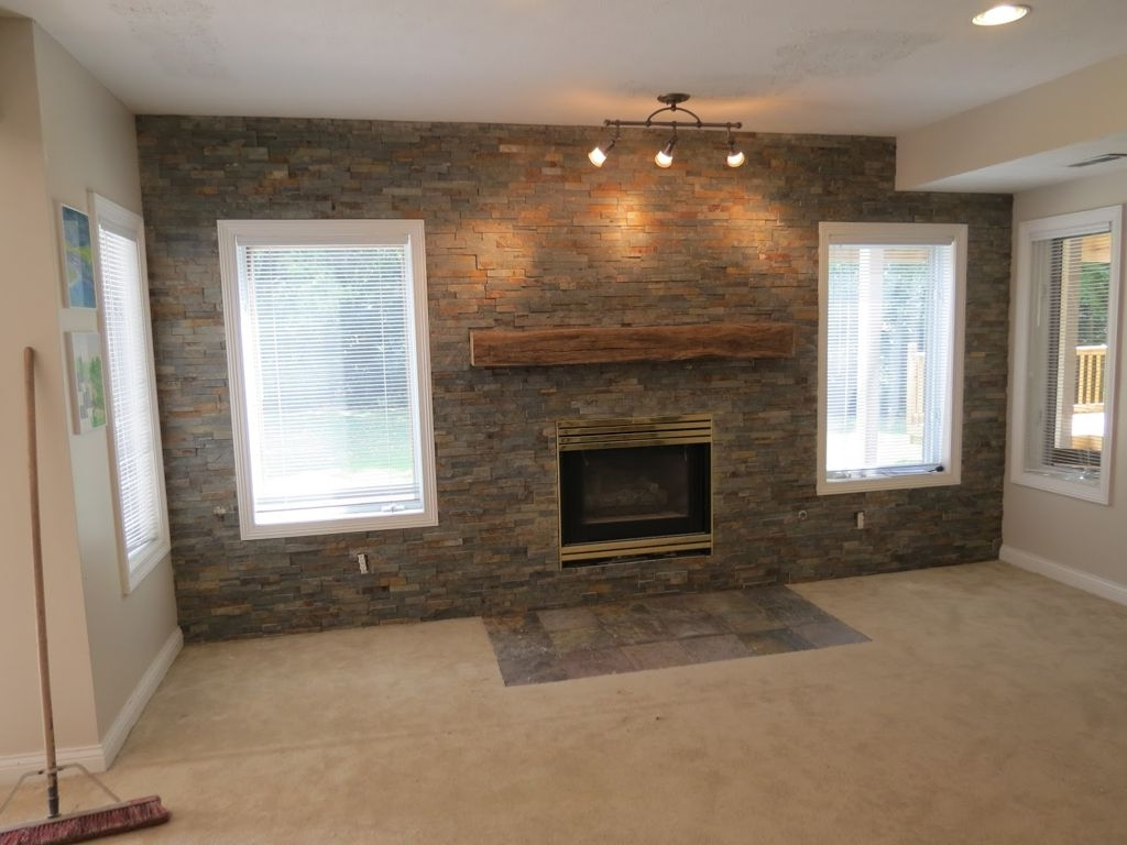 Grey Exposed Brick Stone Accent Wall Combine With Wooden Fireplace Pertaining To Most Popular Wall Accents Over Fireplace (View 15 of 15)