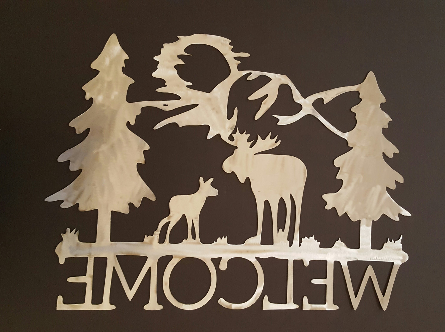 Metal Welcome Sign With Moose Mountains And Pine Trees (View 14 of 20)