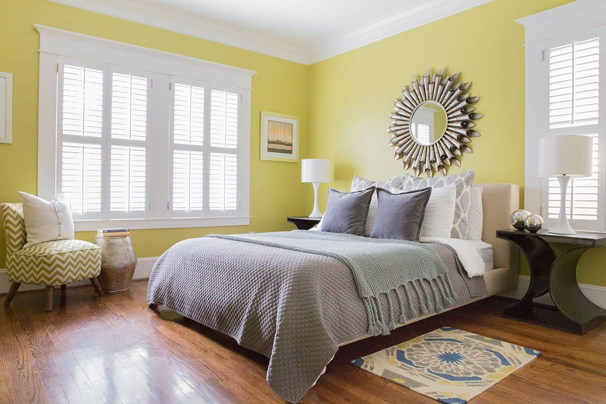 Bedroom With Yellow Warm Paint Colors And Wall Mirror – Warm Paint With Regard To Preferred Yellow Wall Mirrors (View 2 of 20)