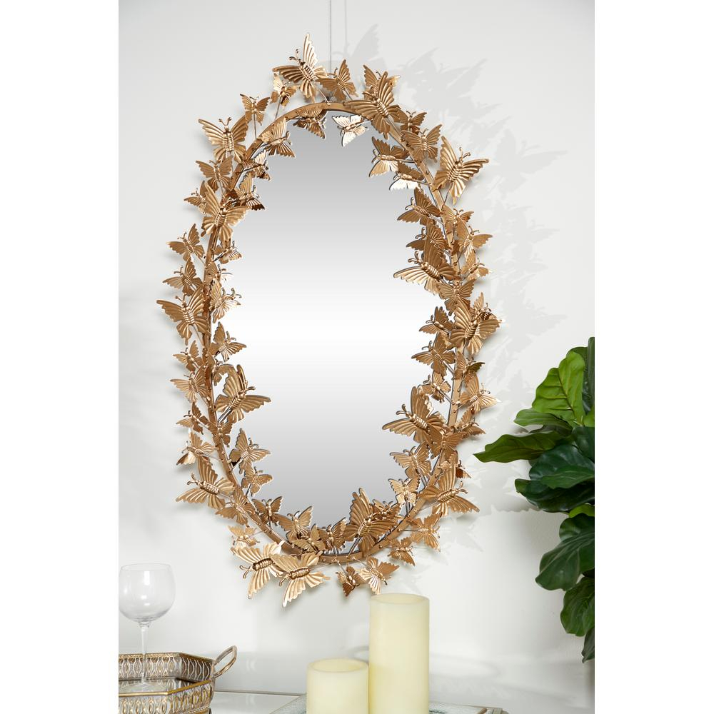 Butterfly Wall Mirrors Pertaining To Well Liked Litton Lane Oval Metallic Gold Butterfly Hanging Wall Mirror  (View 15 of 20)