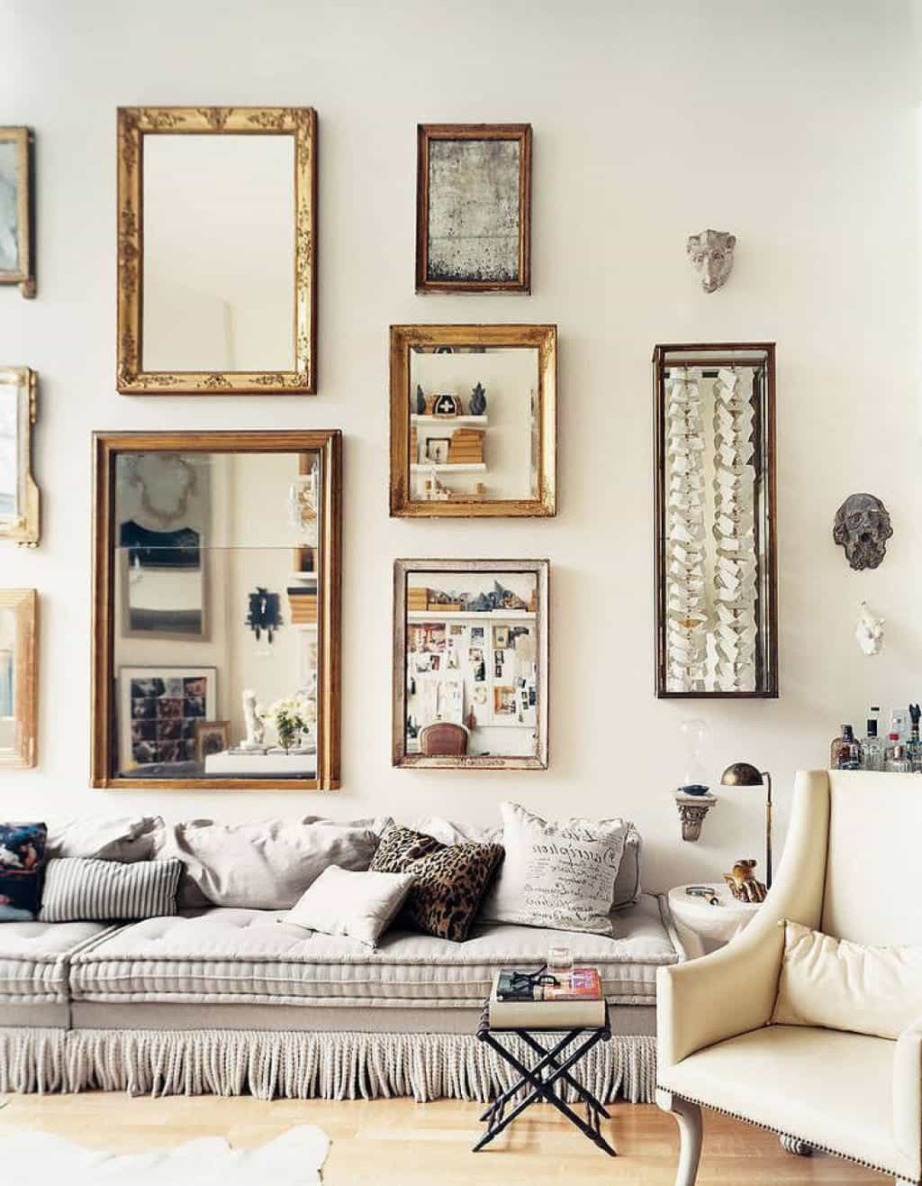 Grey Sofa With Ruffles Against Wall Mirrors And Decor In The Living Intended For Popular Decorative Living Room Wall Mirrors (Gallery 18 of 20)