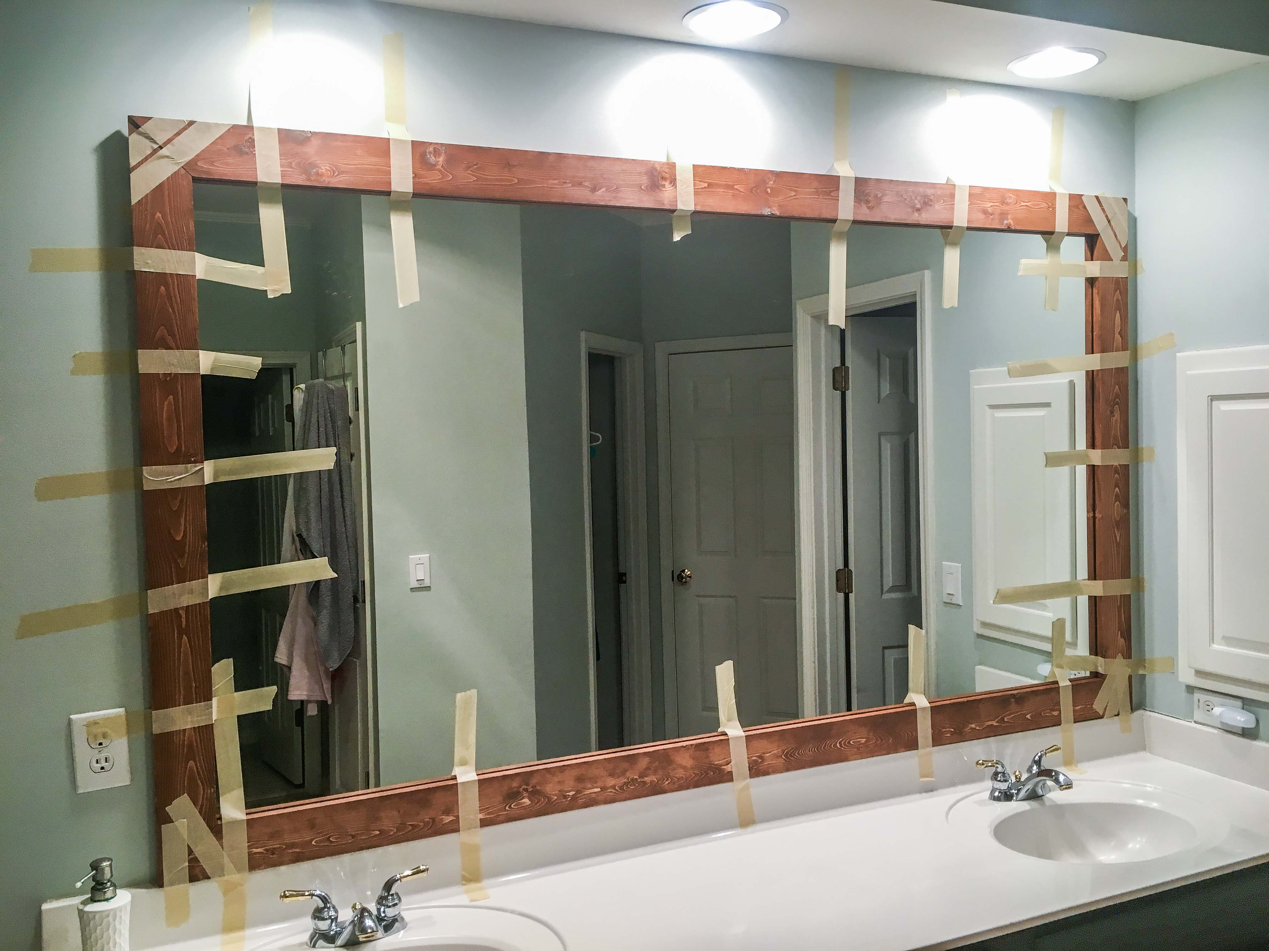 How To Diy Upgrade Your Bathroom Mirror With A Stained Wood For Latest Frame Bathroom Wall Mirrors (View 13 of 20)
