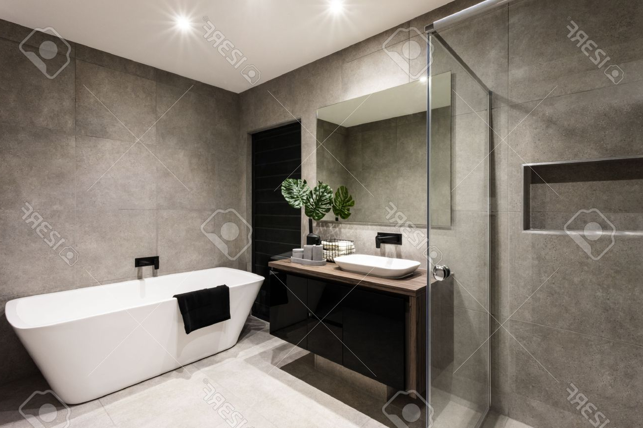 Modern Bathroom With A Shower Area And Bath Tub Including A Wall. (View 14 of 20)