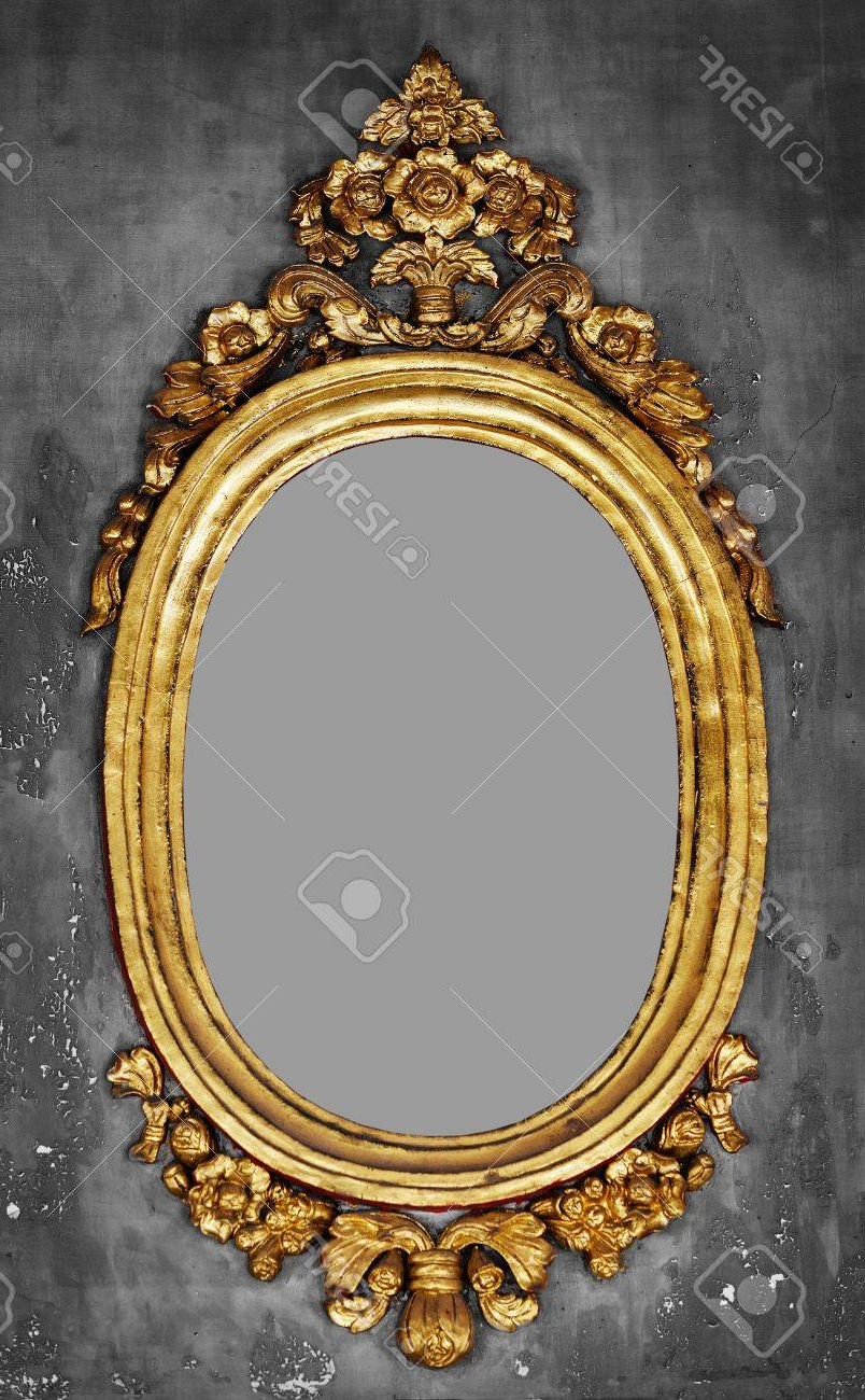 Old Fashioned Oval Gilt Frame For A Mirror On A Gray Concrete. (View 6 of 20)