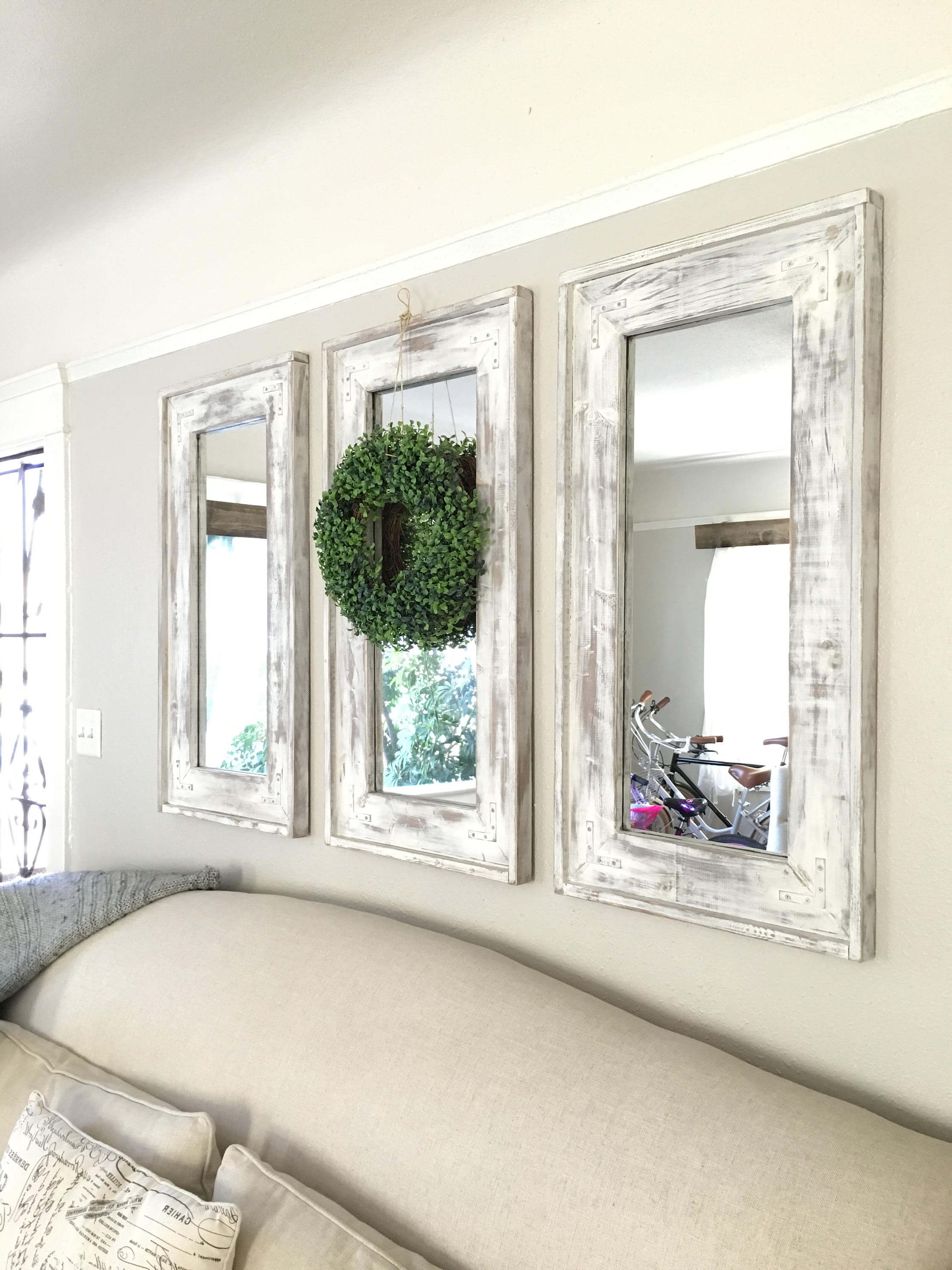 Popular Rustic Wall Mirrors With Regard To Retrofitted Wall Mirrors With Natural Wreath Accent — Homebnc (View 18 of 20)