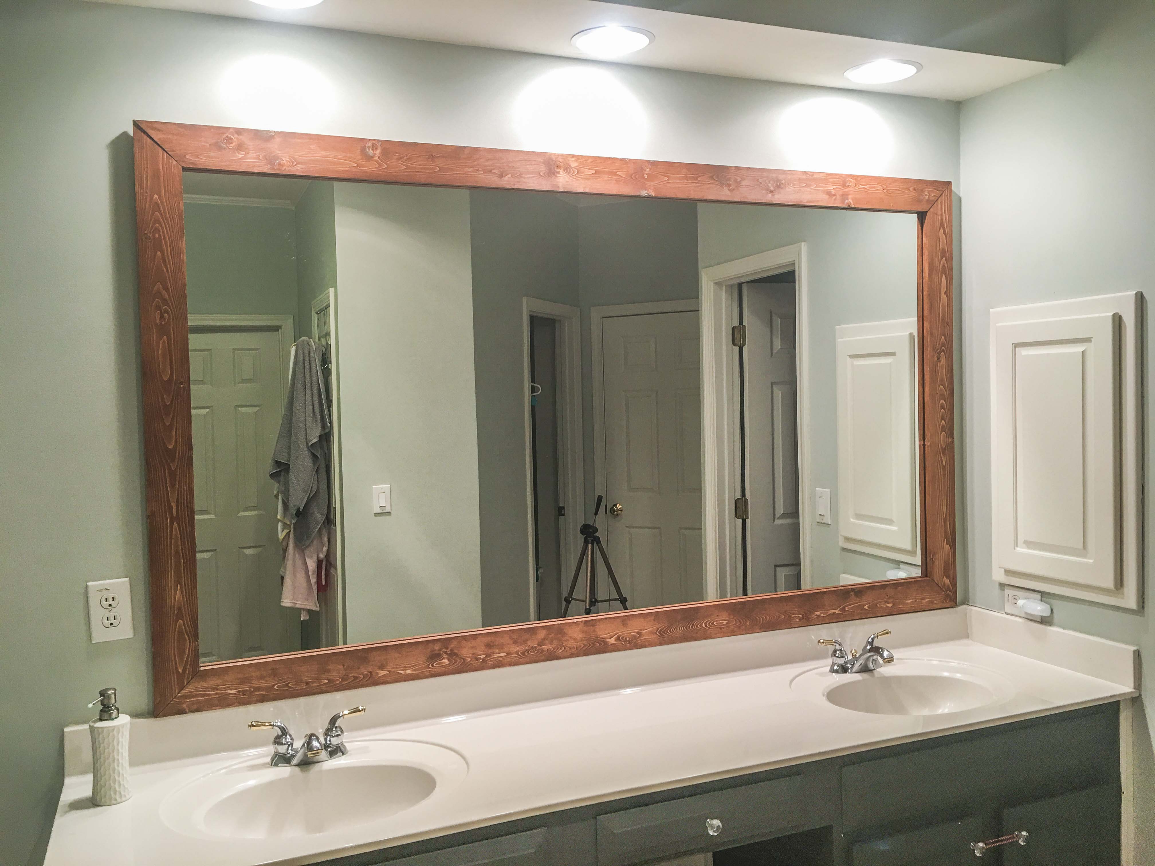 Widely Used How To Diy Upgrade Your Bathroom Mirror With A Stained Wood Regarding Frame Bathroom Wall Mirrors (View 20 of 20)
