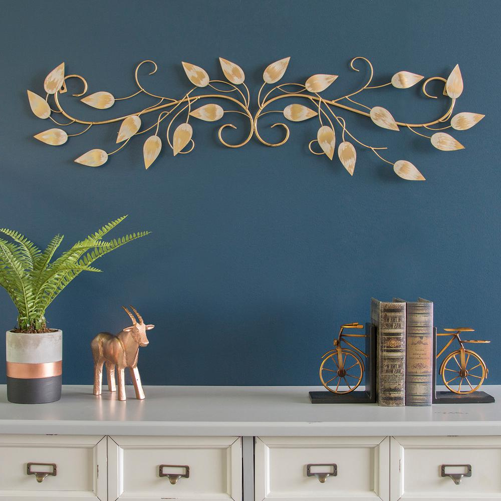 Blowing Leaves Wall Décor Within 2019 Stratton Home Decor Brushed Gold Over The Door Metal Scroll Wall Decor S09607 – The Home Depot (View 20 of 20)